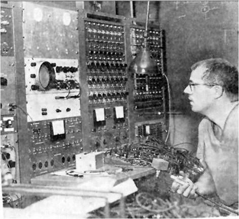 Dr. Warner with his first computer. He translated medical knowledge ­so that computers could assist working doctors.