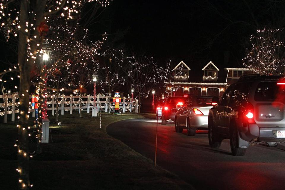 "Traffic was heavy as cars slowly made their way into the entrance of the ""Millis Wonderland."""
