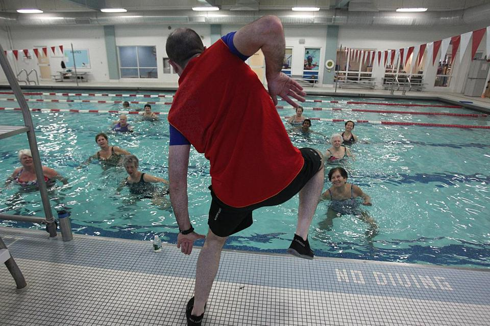 Justin Falxa leads a class at the YMCA in Waltham.