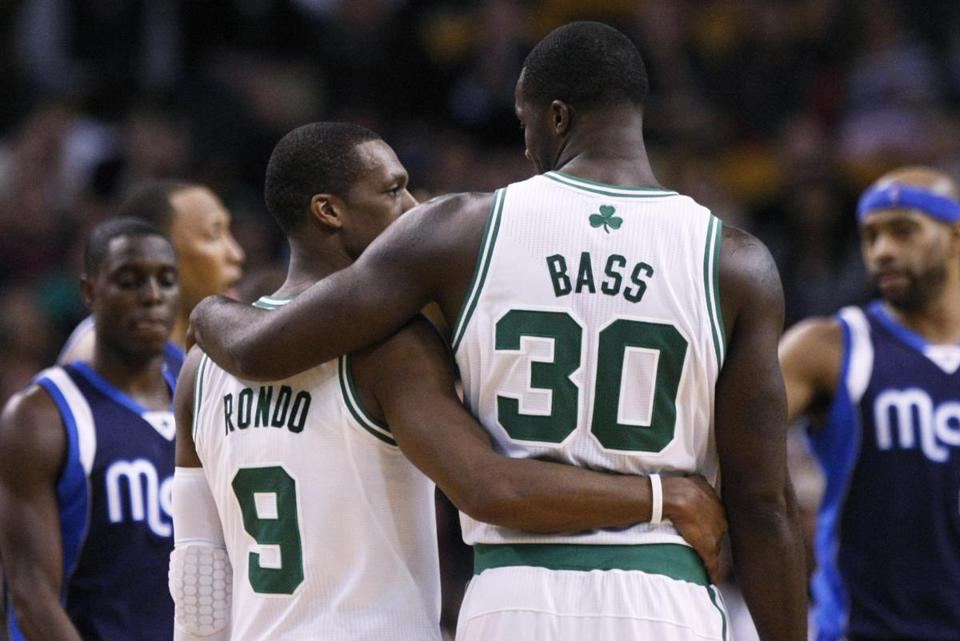 Rajon Rondo needed a helping hand from Brandon Bass in the fourth quarter. Rondo played a game-high 53 minutes.