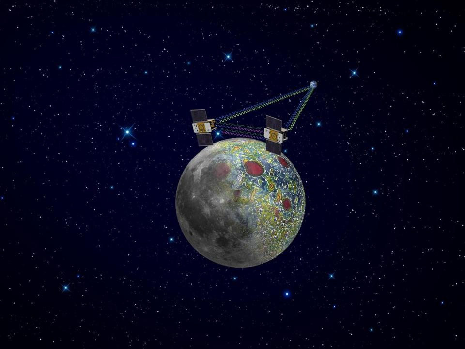 An artist's rendering of GRAIL spacecraft in orbit around the moon. The washing machine-sized spacecraft, named Ebb and Flow, are coming closer and closer to the moon's surface and are expected to crash-land Monday afternoon.