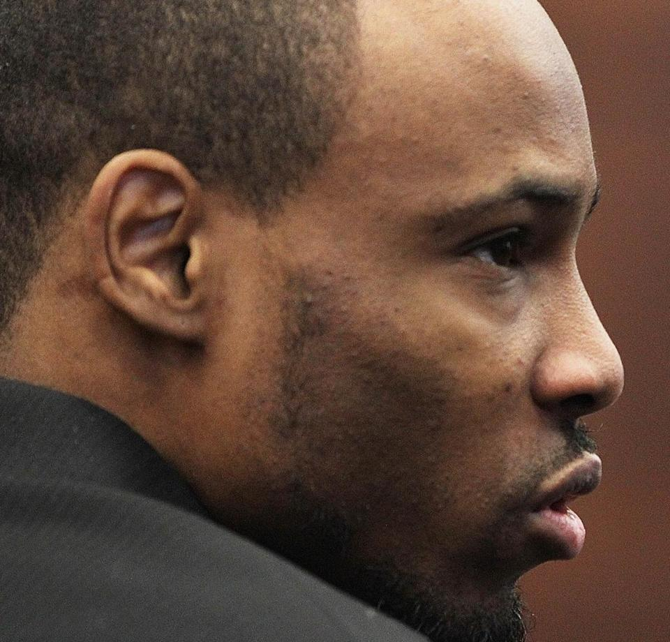 Defendant Dwayne Moore awaited the arrival of the jury before deliberations resumed in the Mattapan massacre case at Suffolk Superior Court in Boston on Friday.
