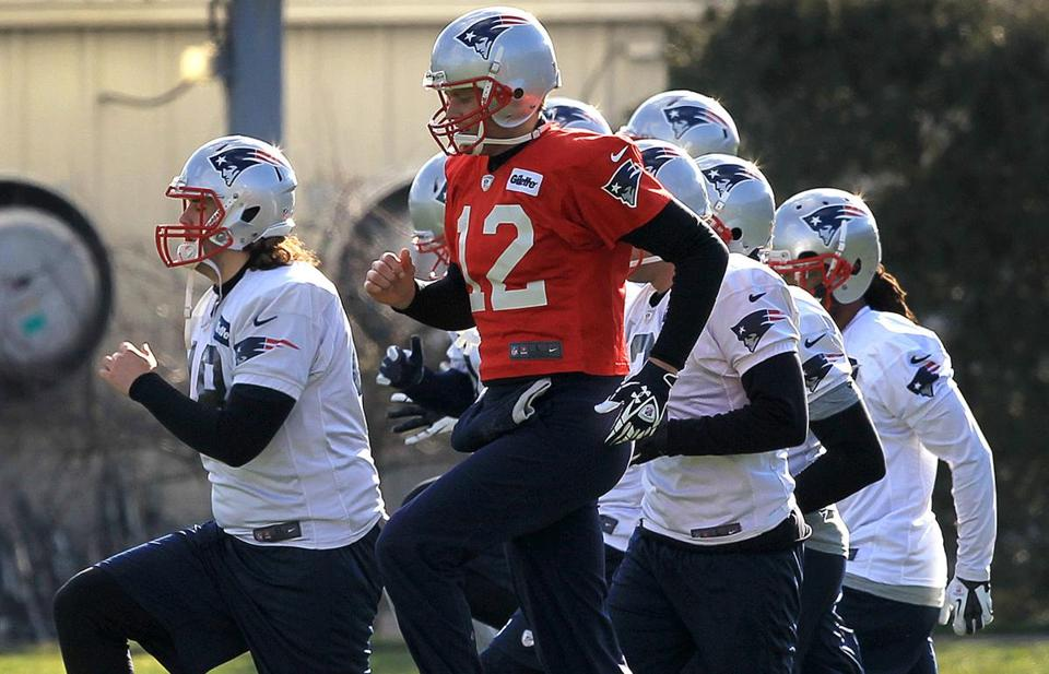 Patriots quarterback Tom Brady joined his teammates running drills at practice in preparation for playing the 49ers on Sunday night.