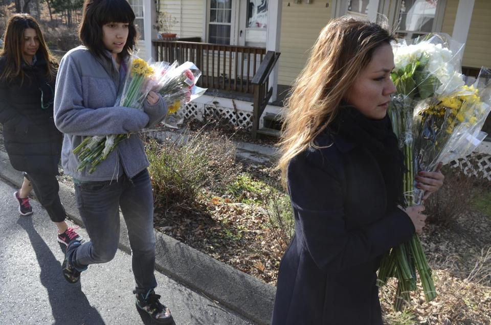 People brought flowers to Sandy Hook Elementary School in Connecticut on Saturday.