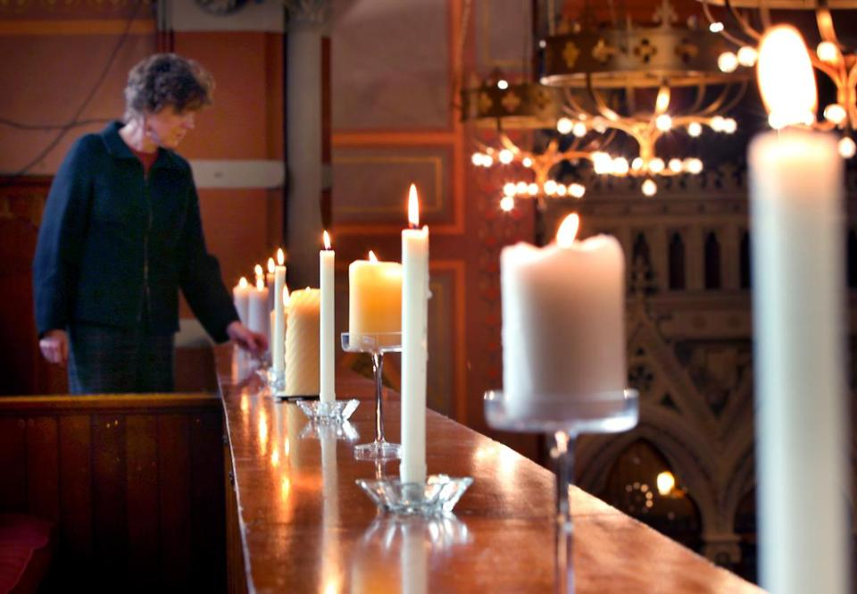 Candles were lit at Boston's Old South Church in memory of the 27 victims who died in a Newtown, Conn., shooting Friday.