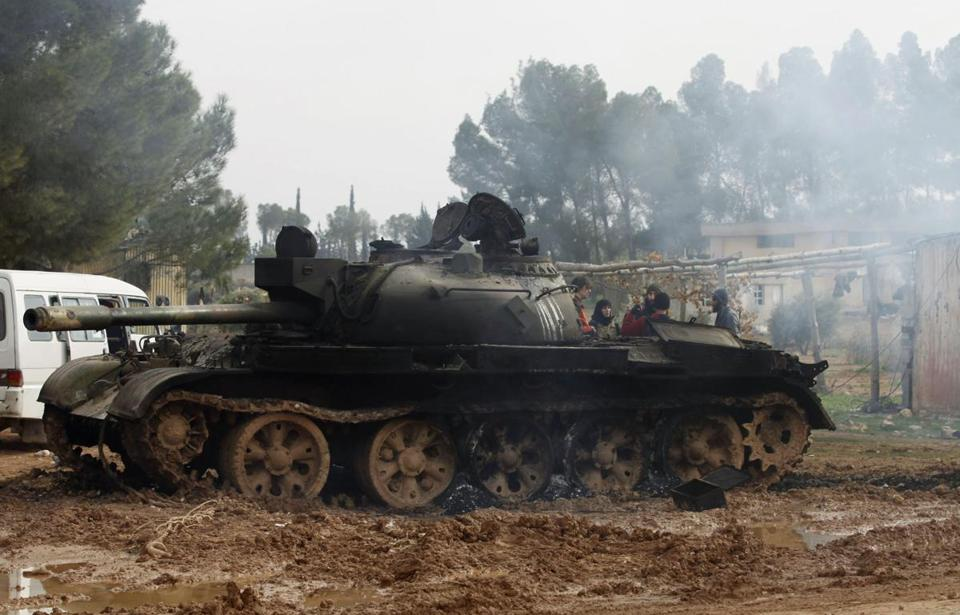 Syrian rebels said they had seized tanks and captured several soldiers at a military base in the city of Aleppo on Sunday.