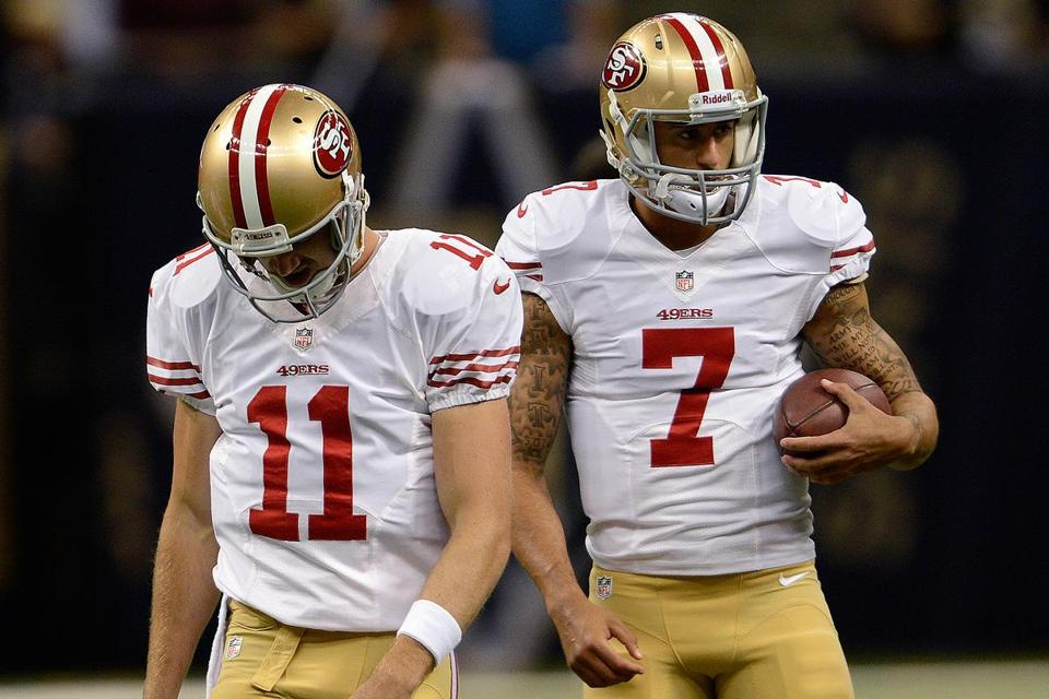 Alex Smith (left), who suffered a concussion Nov. 11, is now healthy, but is also out of luck, having lost his starting job to Colin Kaepernick.