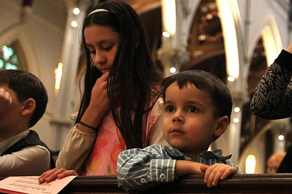 Caterina Franks, 11, and brother Benedict, 3, were at the Cathedral of the Holy Cross in Boston Sunday.