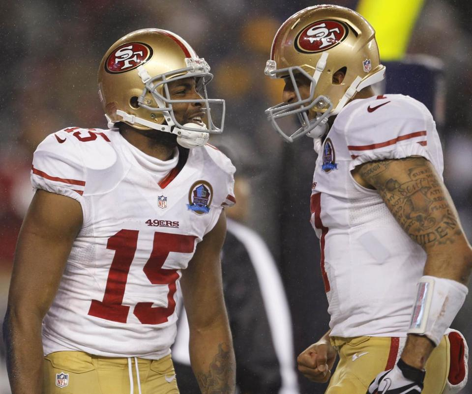 Michael Crabtree, left, and Colin Kaepernick connected for two touchdowns against the Patriots.