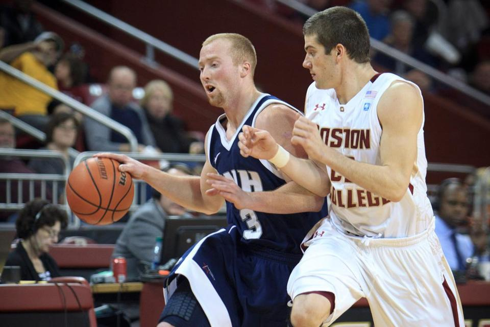 UNH's Chandler Rhoads (10 points) is guarded tightly by BC guard Joe Rahon.