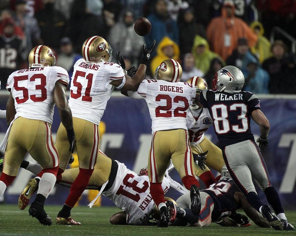 This fumble by Stevan Ridley (on ground) wound up in the hands of the waiting 49ers.