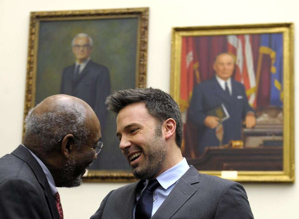 Ben Affleck talks with Johnnie Carson, assistant secretary of state for the Bureau of African Affairs.