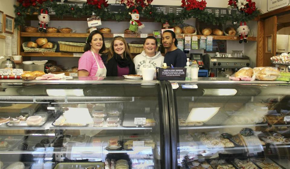 Ann Azul (left) took over Stoughton Bakery three years ago and has steadily expanded the offerings, which include the pastries below. Azul's children, Ashley (from left) and son, Lino, along with Raymond Williams, help with the work.