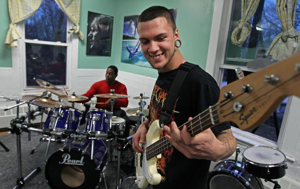 Richard Pingree (right, on bass) and Levaughn Fussell (backround, on drums) play during a music session at the Plummer Home for Boys in Salem.