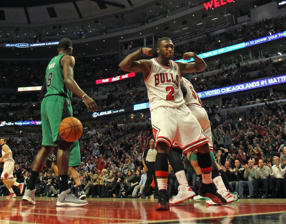 Former Celtic Nate Robinson (2) put on a display, scoring 12 of his 18 points in the fourth.