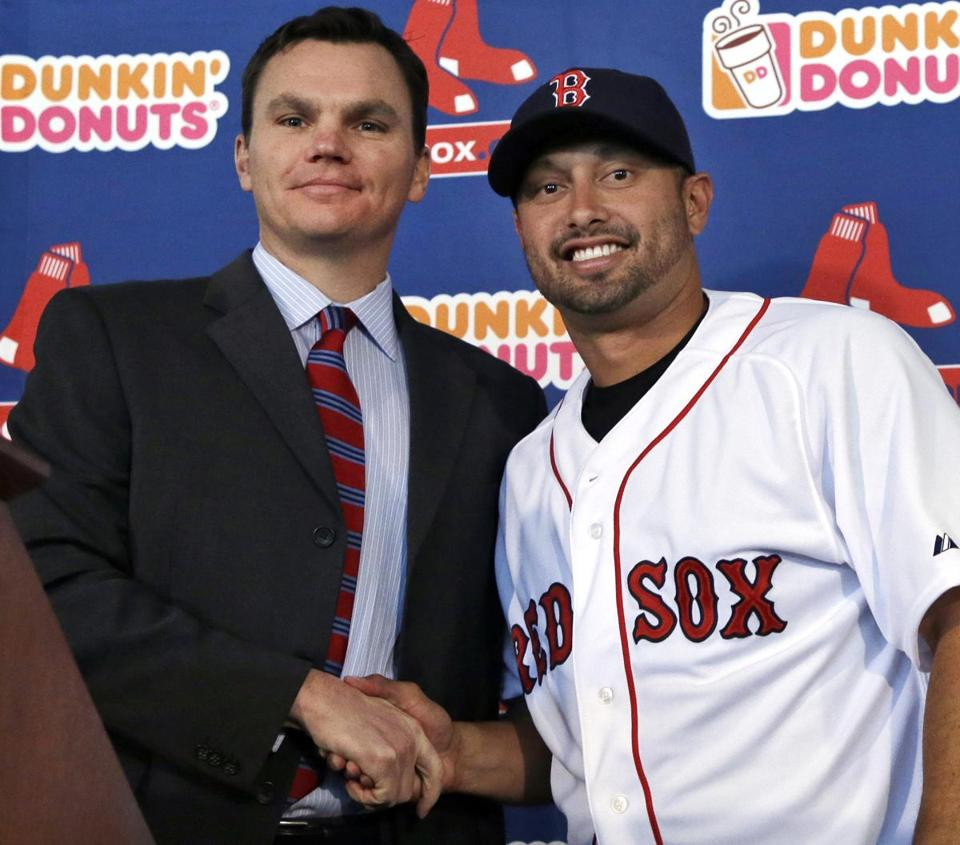Red Sox GM Ben Cherington has added several new players, such as outfielder Shane Victorino.