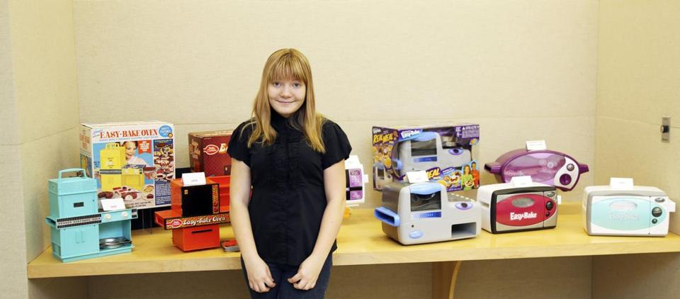 McKenna Pope is seen in front of earlier models of the Easy-Bake Oven during her trip to the Hasbro headquarters in Pawtucket, R.I.
