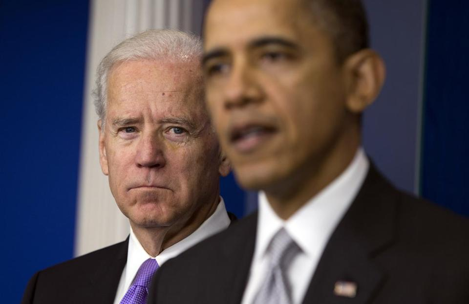 Vice President Joe Biden, left, listens as President Obama announces Wednesday that Biden will lead an administrationwide effort to curb gun violence.