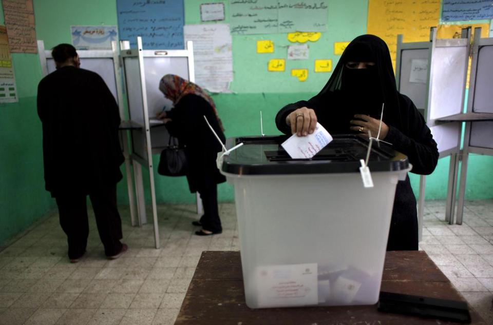 Egyptians cast ballots Saturday in Giza in the second round of voting on a new constitution.