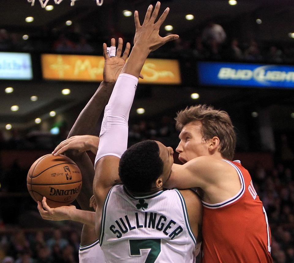 Jared Sullinger gets a face full of elbow from the Bucks' Mike Dunleavy, but it was the Celtics forward who picked up a foul on the play.