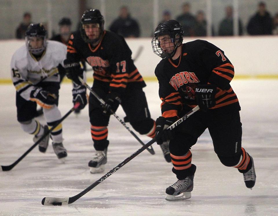 Captains Joe Connors (17) and Jared Baker (7) are veteran first-line forwards who are teaching younger players about Woburn's traditions.