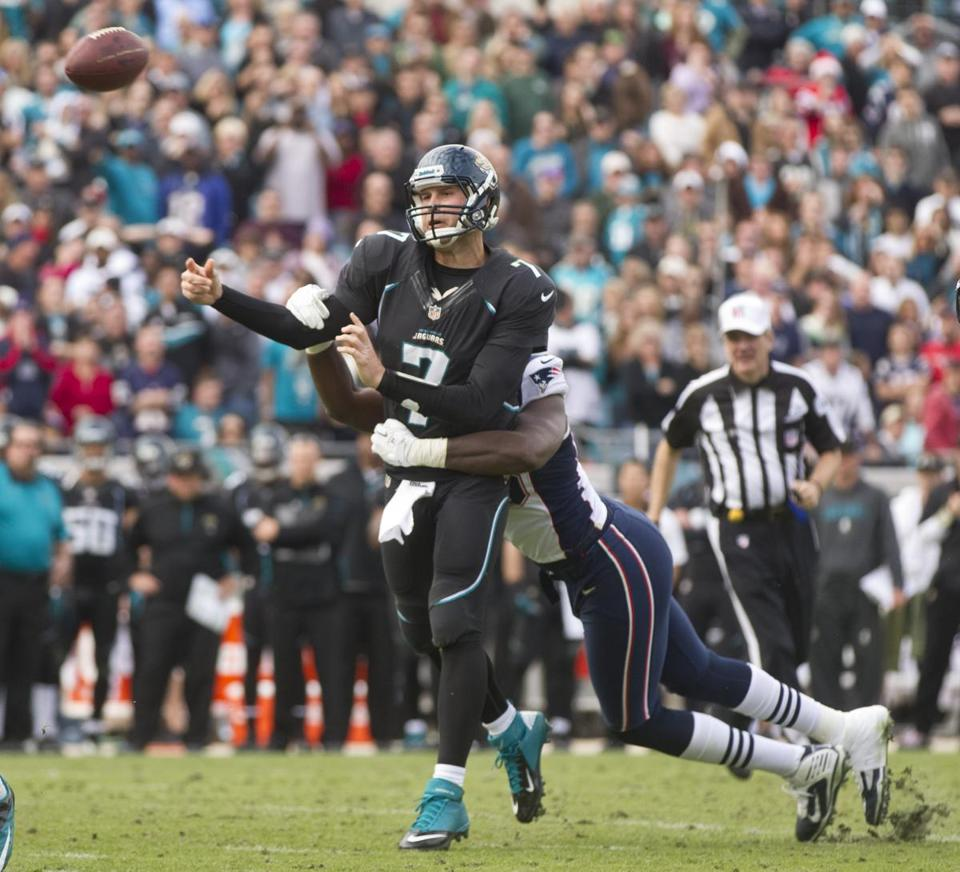 Chandler Jones hits Jaguars quarterback Chad Henne, leading to an interception near the goal line by Patrick Chung.