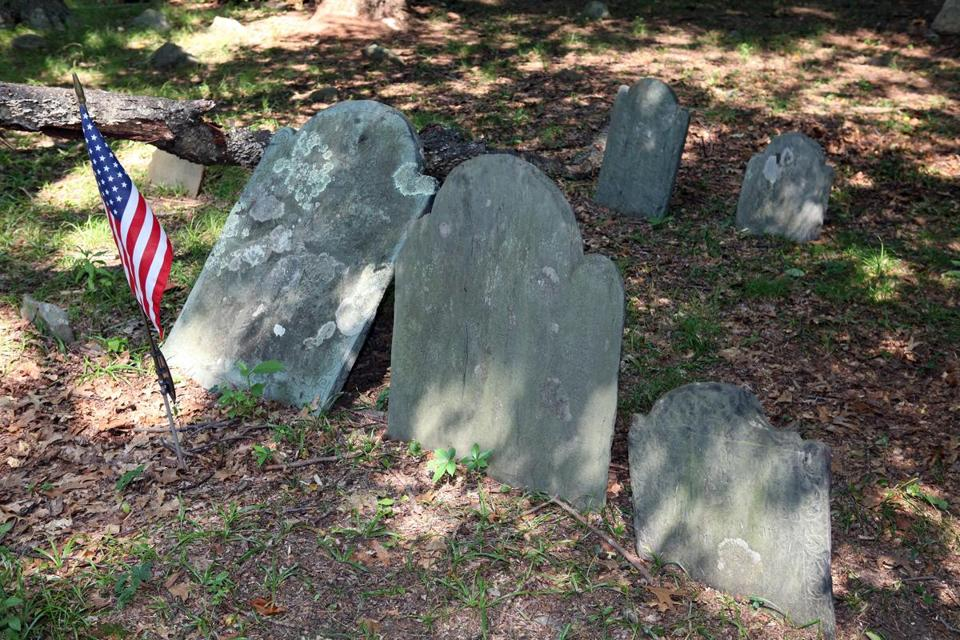 Stones were cleaned or reset in historic burying grounds.