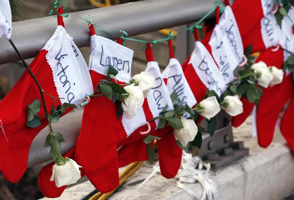 Stockings with shooting victims' names were displayed.