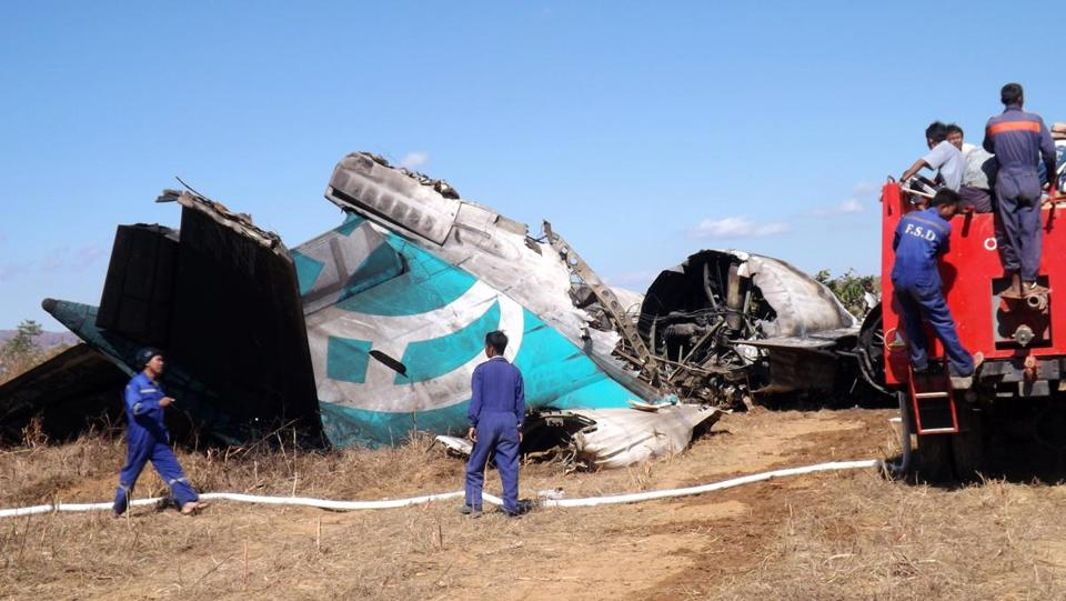 Members of a fire brigade team Wednesday inspected an Air Bagan passenger jet that crash-landed in Myanmar.