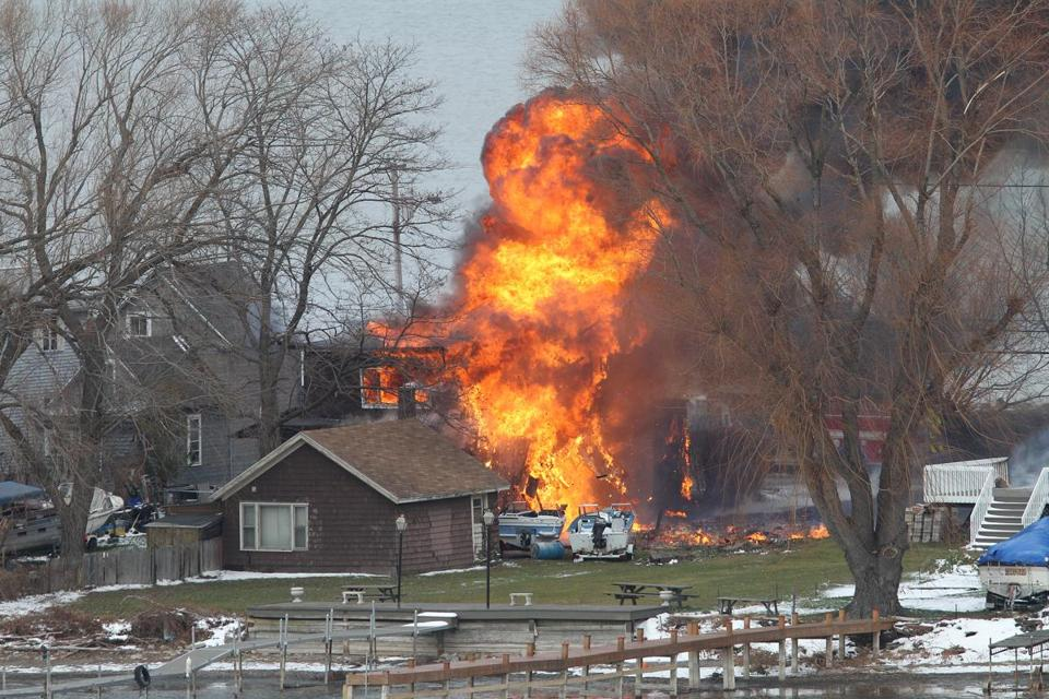 A house burned Monday in Webster, N.Y., after a former convict set it ablaze to lure firefighters.