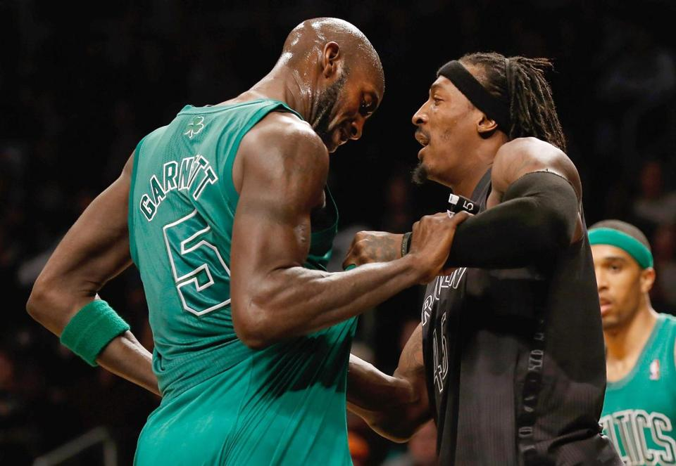 Kevin Garnett did not appreciate the wardrobe adjustment that Gerald Wallace of the Nets gave him during this tussle.