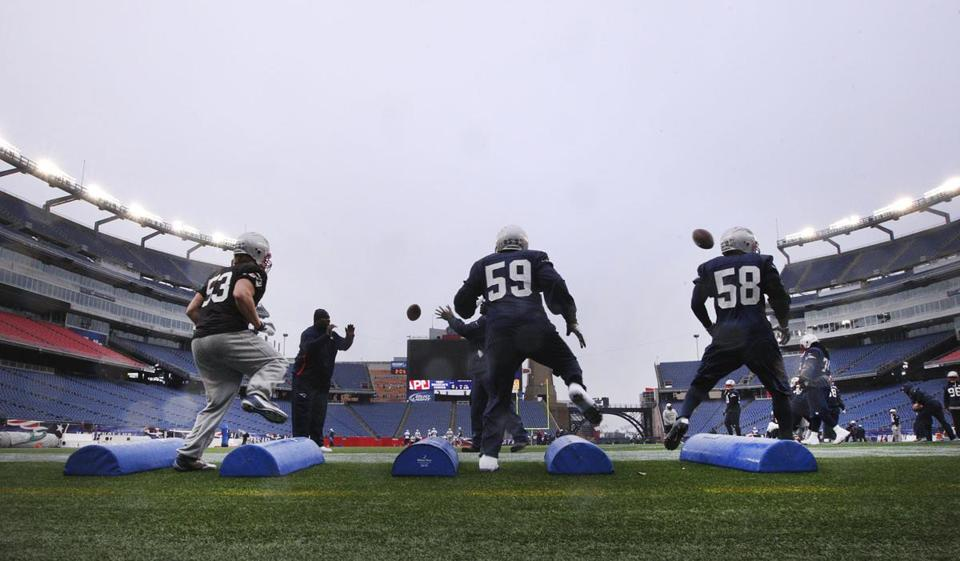 The Patriots practiced outside in the elements Thursday in preparation for Sunday's regular-season finale against the warm-weather Dolphins.