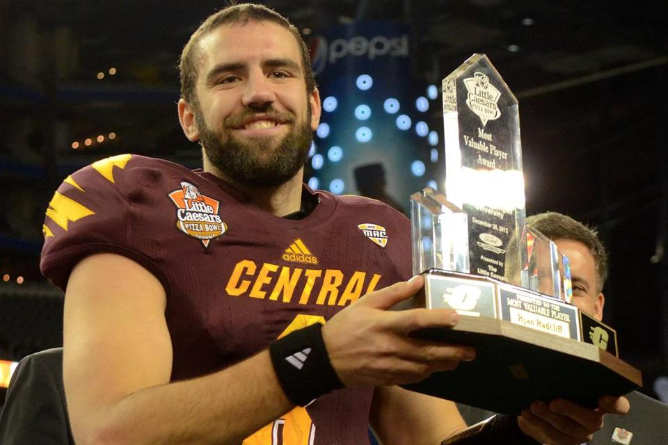 Central Michigan quarterback Ryan Radcliff holds up the Little Caesars Pizza Bowl Most Valuable Player Trophy after the victory over Western Kentucky.