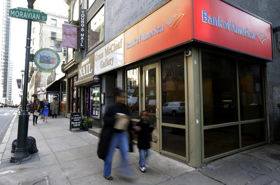 Big institutions such as Bank of America say earnings are up partly because they have shed jobs and bad loans.