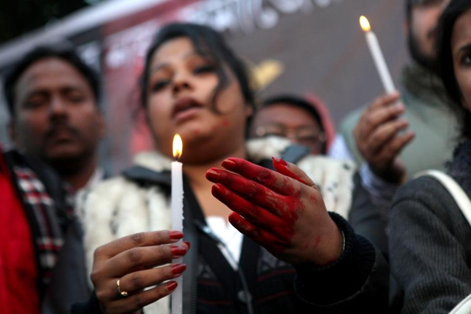 A woman, with a hand covered in fake blood, joined a rape protest on Friday in Calcutta.