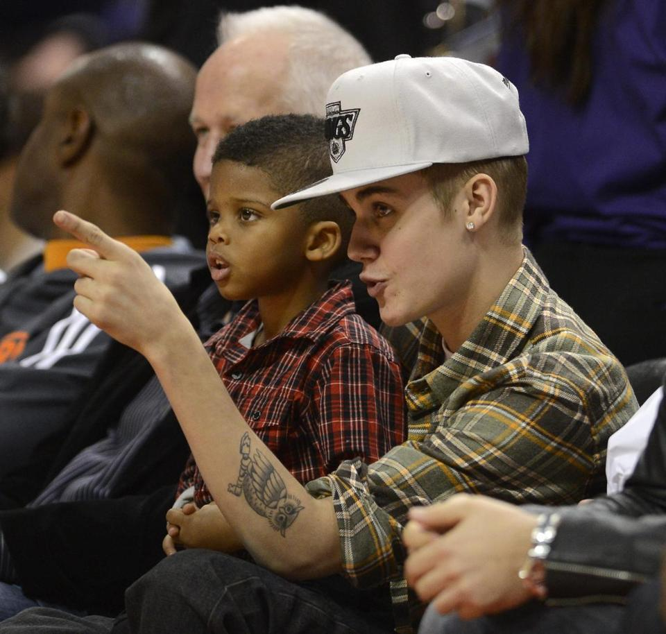 Justin Bieber with Chris Paul Jr. at the Celtics-Clippers game in Los Angeles.