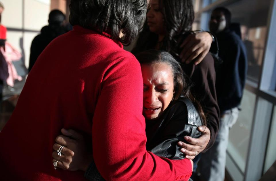 Brenda Morris (center) and Claudette Flanagan-Jones, the grandmothers of Jade Morris, consoled each other Friday.