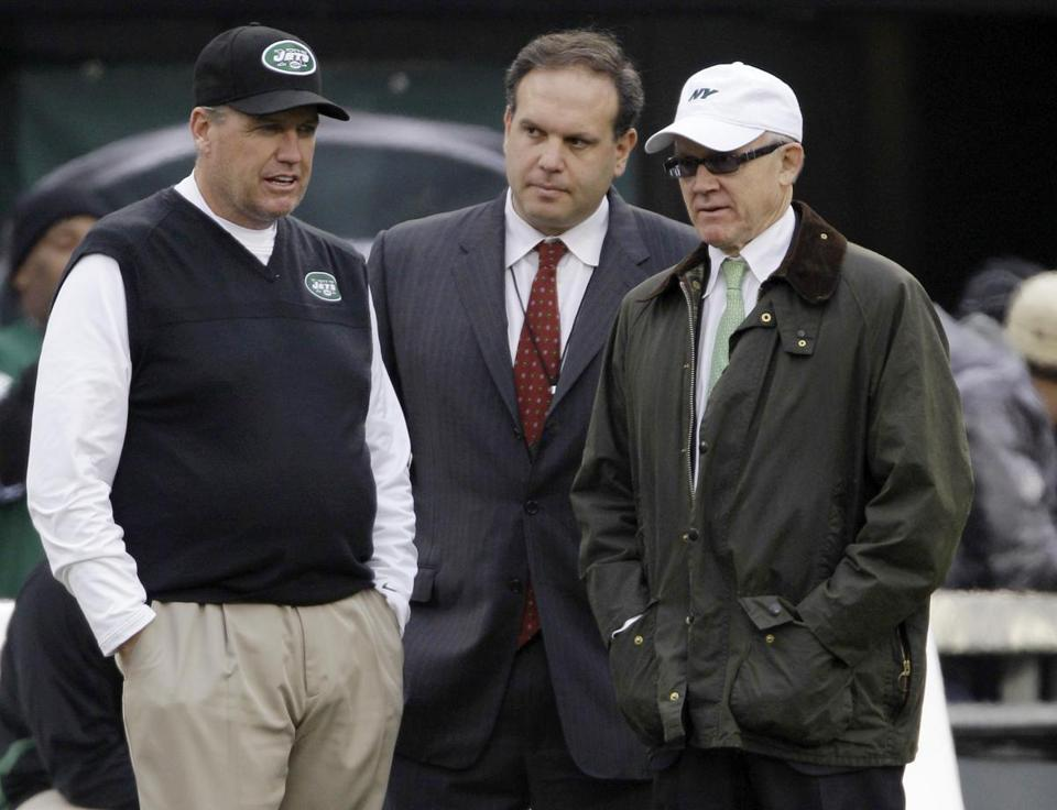 Rex Ryan (left) denied a report that he'd be happy to leave if owner Woody Johnson (right) doesn't make changes.