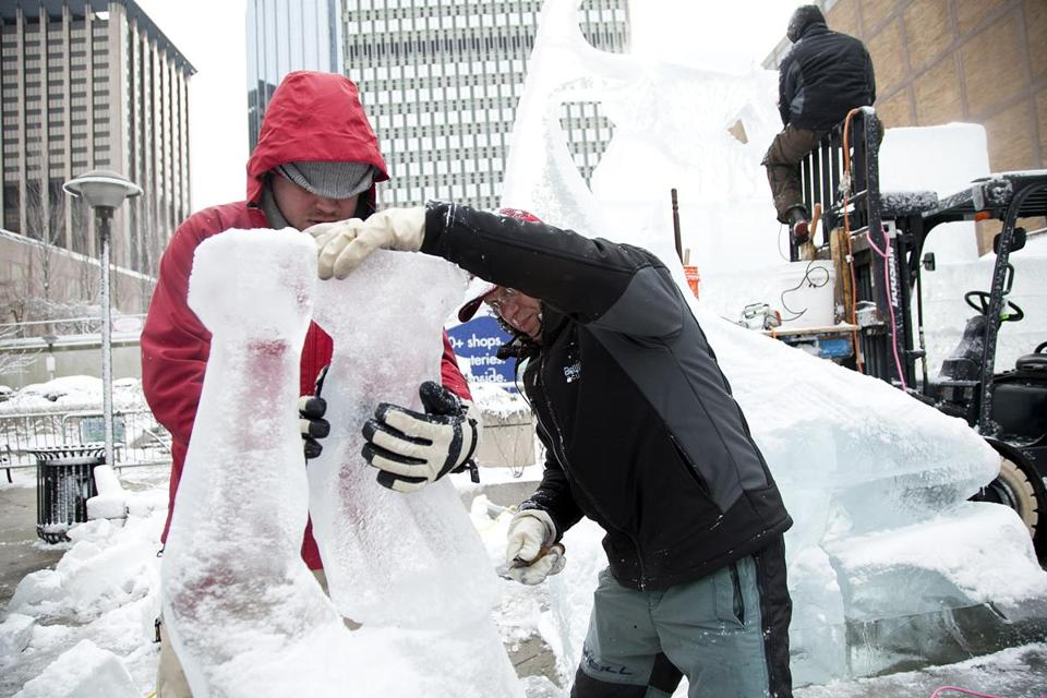 Donald Chapelle (right) and Andy Campbellworked on an ice sculpture Sunday at Boylston Plaza in front of the Prudential Center.