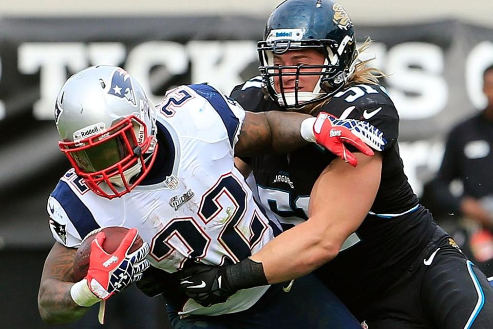 Longtime Patriot Kevin Faulk had some issues with fumbling, but he has helped Stevan Ridley (above) deal with his.