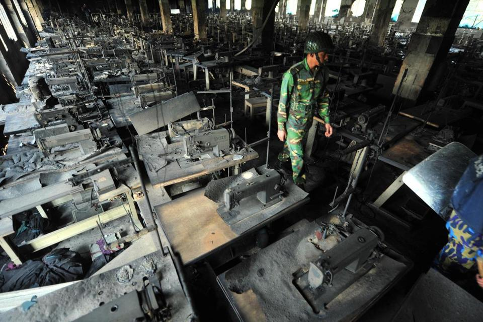 A Bangladeshi Army soldier walked through rows of burnt sewing machines after a November factory fire killed 112 workers.