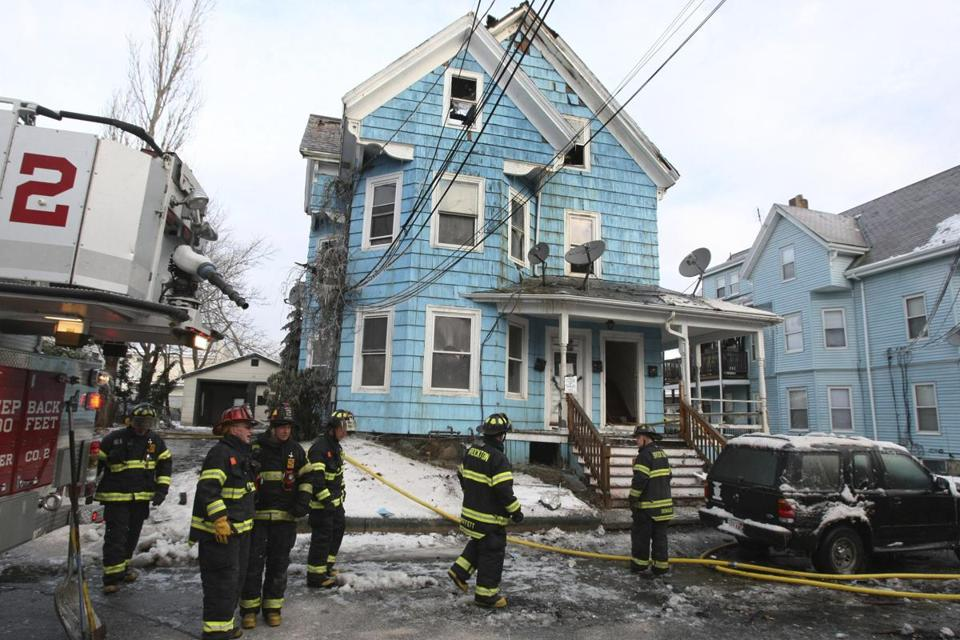 Brockton firefighters battled a three-alarm fire in a boarded-up building on Monday.
