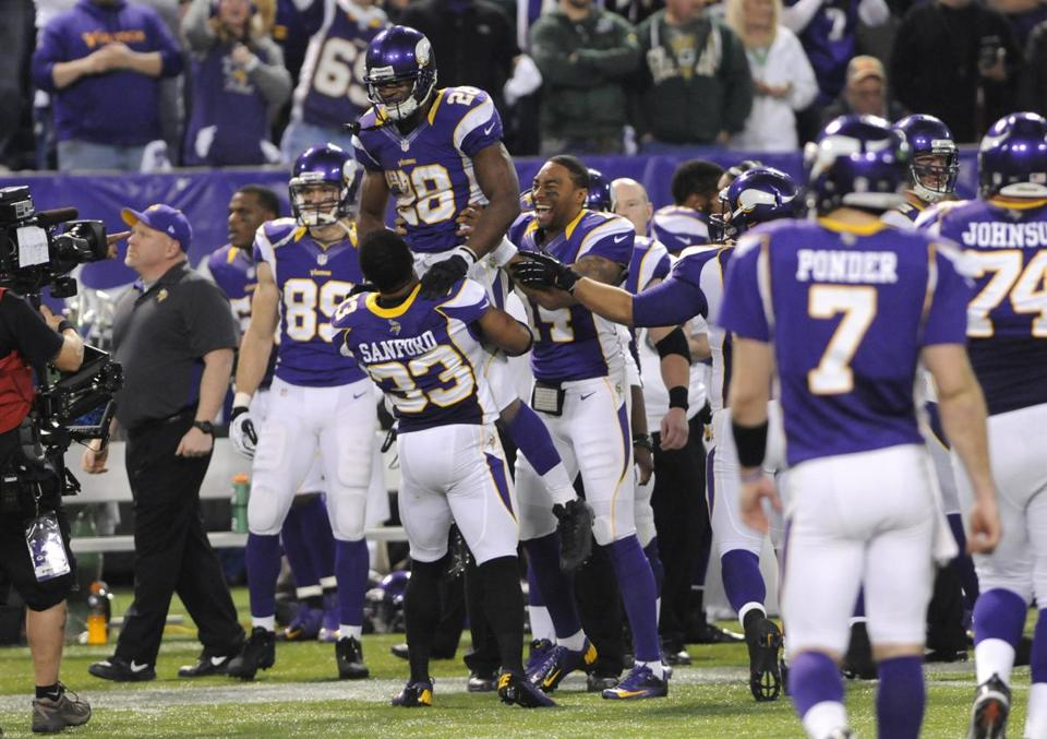 Adrian Peterson (28) was happy to celebrate a playoff berth with teammates.