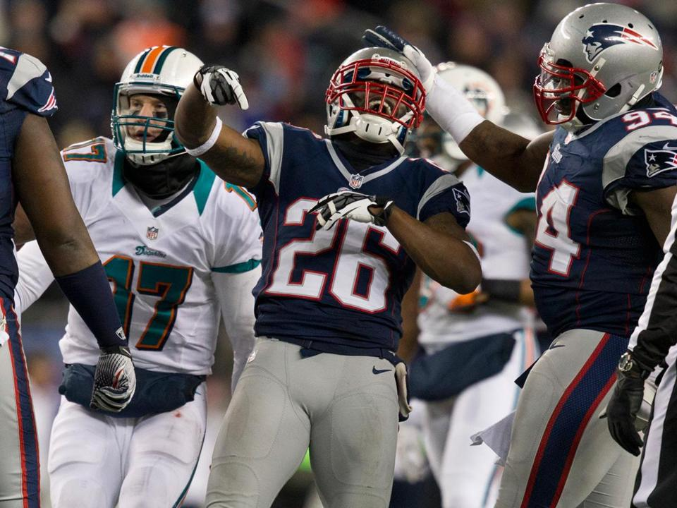 Patriots Derrick Martin (left) and Justin Francis celebrated one of the team's season-high seven sacks in a 28-0 win over the Dolphins in Gillette Stadium on Sunday.
