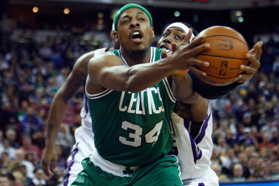 Paul Pierce, who scored 20 points in a losing effort, scraps for a loose ball in front of John Salmons during the first half.