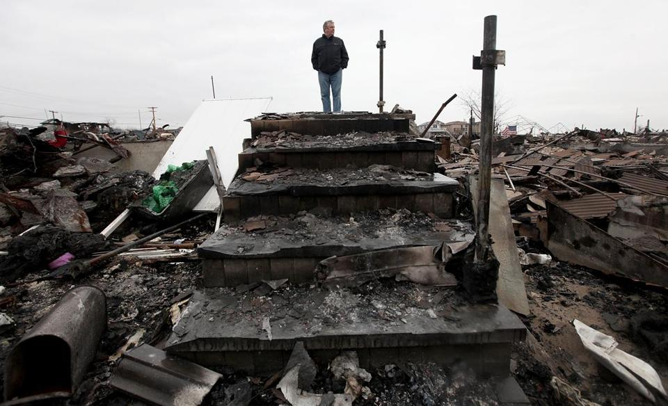Dennis Kane stood above the charred remains of his destroyed home in the Breezy Point section of Queens.