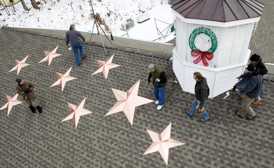 Twenty-six stars were installed on the roof of the Sandy Hook fire station to commemorate the shooting victims.
