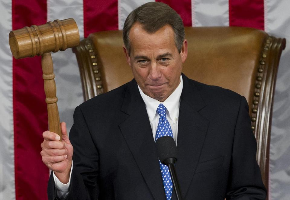 House Speaker John Boehner raised his oversized gavel after reclaiming his post on Thursday.