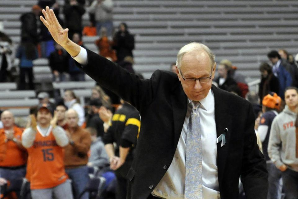 Syracuse head coach Jim Boeheim acknowledged the fans after his team defeated Rutgers 78-53 for his 903rd career victory.