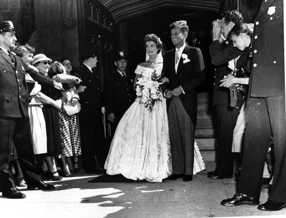 Senator John F. Kennedy, D-Mass., is shown with his bride, the former Jacqueline Bouvier, leaving a Newport, RI church after their wedding on September 12, 1953.